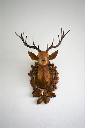 deer hunt - A plastic deer head on a wall Stock Photo - Premium Royalty-Free, Code: 653-01666065
