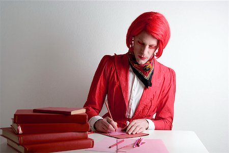 Drag queen sitting at desk Stock Photo - Premium Royalty-Free, Code: 653-01666531