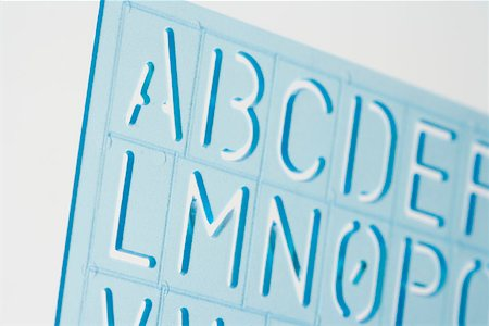 stencils - Close-up of a plastic stencil Stock Photo - Premium Royalty-Free, Code: 653-01661539