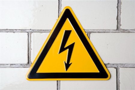 A 'High voltage' warning sign Stock Photo - Premium Royalty-Free, Code: 653-01662089