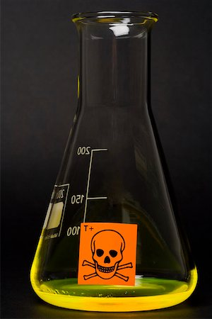 poison - Toxic label on conical flask containing yellow liquid Stock Photo - Premium Royalty-Free, Code: 653-01662094