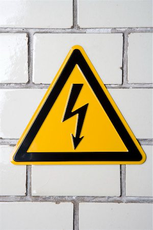 A 'High voltage' warning sign Stock Photo - Premium Royalty-Free, Code: 653-01662111