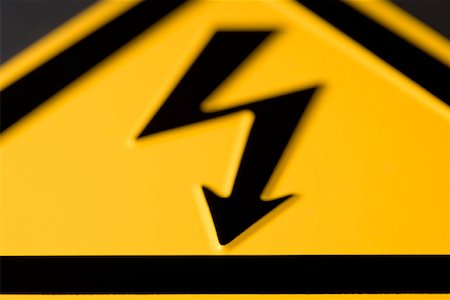 Close-up of 'High voltage' warning sign Stock Photo - Premium Royalty-Free, Code: 653-01662159