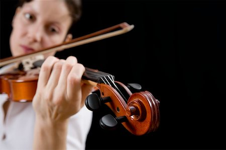 scroll (design) - Woman playing a violin Stock Photo - Premium Royalty-Free, Code: 653-01662403