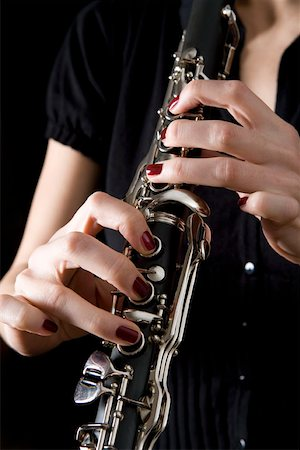 Woman playing a clarinet Stock Photo - Premium Royalty-Free, Code: 653-01662416