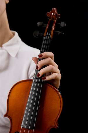 scroll (design) - Woman holding a violin Stock Photo - Premium Royalty-Free, Code: 653-01662460