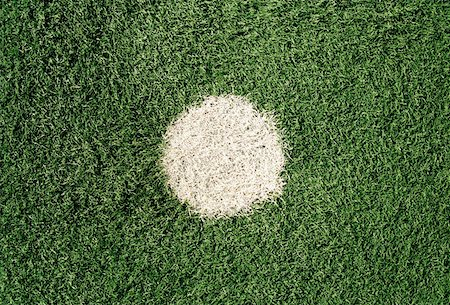 spot paint - White dot on sports field Stock Photo - Premium Royalty-Free, Code: 653-01662606