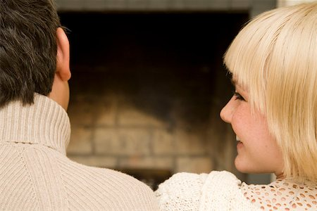 sweater and fireplace - Young couple sitting in front of an open fire together Stock Photo - Premium Royalty-Free, Code: 653-01662687