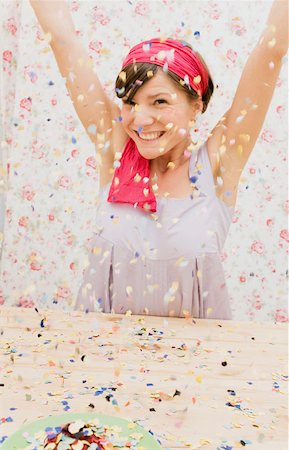 A young woman throwing confetti Stock Photo - Premium Royalty-Free, Code: 653-01697089