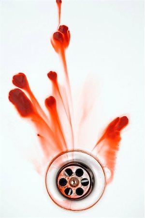 Blood washing down a plughole Stock Photo - Premium Royalty-Free, Code: 653-01697768