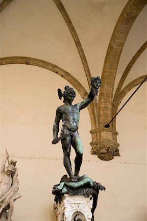 statue of david - A statue of David and Goliath Stock Photo - Premium Royalty-Free, Code: 653-01697960