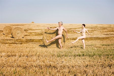 A naked man and woman marching through a field Stock Photo - Premium Royalty-Free, Code: 653-01698178