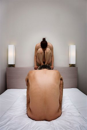 The back of a naked man in a crouched position and the front of a naked woman in a crouched position Stock Photo - Premium Royalty-Free, Code: 653-01698172