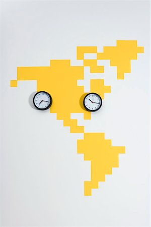 Clocks on a world map Stock Photo - Premium Royalty-Free, Code: 653-01698202