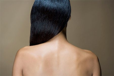 Rear View of a woman with long black hair Stock Photo - Premium Royalty-Free, Code: 653-01698378