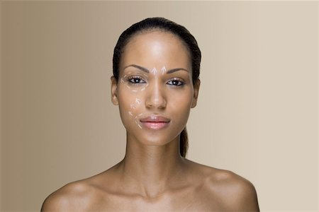 A woman with cosmetic surgery lines on her face Stock Photo - Premium Royalty-Free, Code: 653-01698386