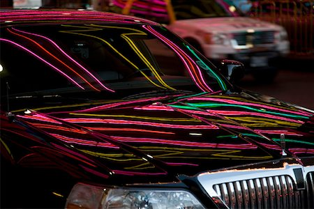Neon lights reflecting on a limousine Stock Photo - Premium Royalty-Free, Code: 653-01698614