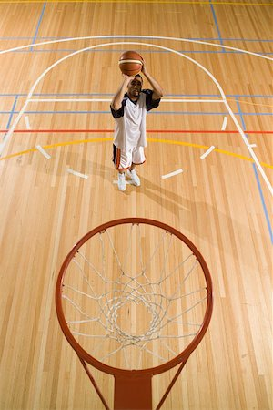 scoring - A young man about to shoot a basket Stock Photo - Premium Royalty-Free, Code: 653-02001309