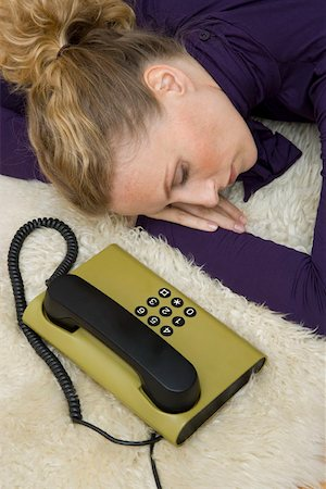 phone cord - A woman asleep next to a landline phone Stock Photo - Premium Royalty-Free, Code: 653-02002576