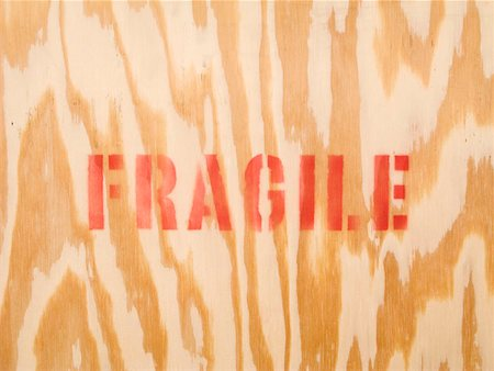 stencils - The word fragile stenciled on wood Stock Photo - Premium Royalty-Free, Code: 653-02078387