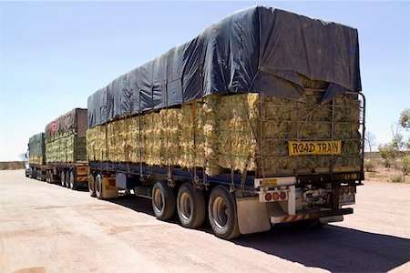 side view tractor trailer truck - A lorry carrying bales of hay Stock Photo - Premium Royalty-Free, Code: 653-02078645