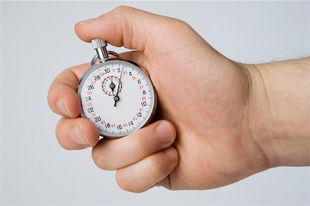 stop watch - A hand holding a stopwatch Stock Photo - Premium Royalty-Free, Code: 653-02078729