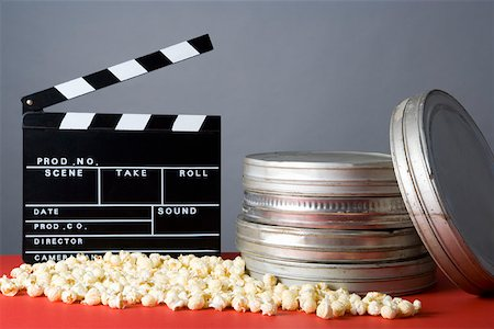 slate - Clapperboard, popcorn and film reels Stock Photo - Premium Royalty-Free, Code: 653-02078926