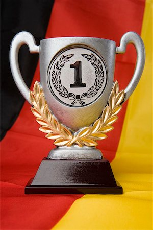 First place trophy sitting on a German flag Stock Photo - Premium Royalty-Free, Code: 653-02260344
