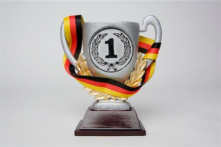 First place trophy cup wrapped in a sash with the German flag colors Stock Photo - Premium Royalty-Free, Code: 653-02260365