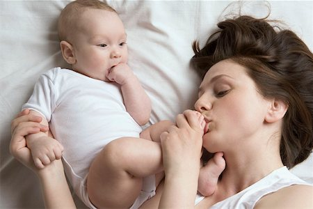 A mother kissing her baby's foot Stock Photo - Premium Royalty-Free, Code: 653-02260641