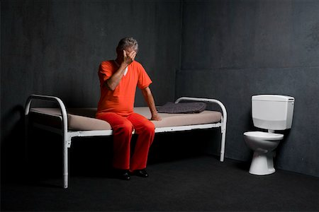 A prisoner in his prison cell Stock Photo - Premium Royalty-Free, Code: 653-02261079