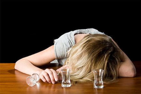 drunk passed out - A young woman passed out drunk on a bar counter Stock Photo - Premium Royalty-Free, Code: 653-02261345