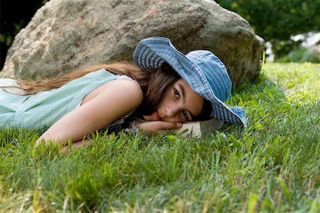 A girl lying in grass Stock Photo - Premium Royalty-Free, Code: 653-02261379