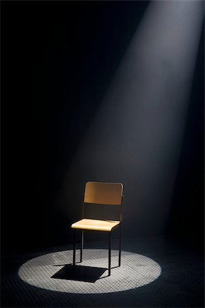 A spot lit empty chair Stock Photo - Premium Royalty-Free, Code: 653-02634285