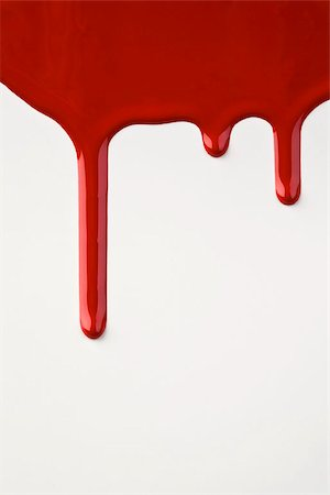 paint drips - Red paint dripping down a white wall Stock Photo - Premium Royalty-Free, Code: 653-02634314