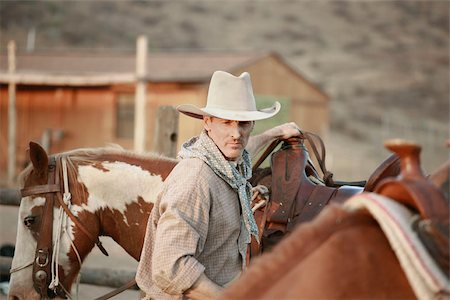 A cowboy working on a ranch with horses Stock Photo - Premium Royalty-Free, Code: 653-02634462