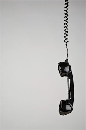 phone cord - A telephone receiver hanging Stock Photo - Premium Royalty-Free, Code: 653-02635156