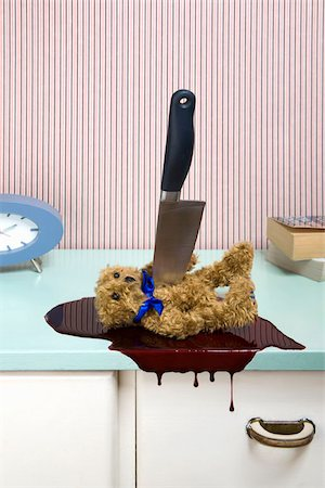 dripping blood - Knife stabbing a teddy bear on a dresser Stock Photo - Premium Royalty-Free, Code: 653-02635216