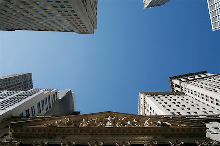 stock exchange building - Low angle view of the sky above Wall Street Stock Photo - Premium Royalty-Free, Code: 653-02635302