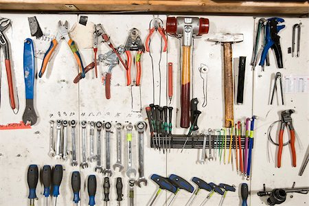 Hand tools arranged on a wall Stock Photo - Premium Royalty-Free, Code: 653-02635343