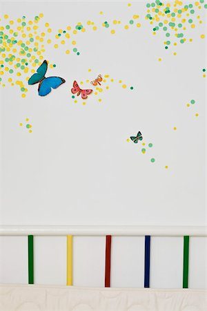 spot paint - A child's bedroom wall decorated with paint spots and butterflies Stock Photo - Premium Royalty-Free, Code: 653-02635430