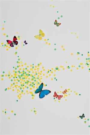 A child's bedroom wall decorated with paint spots and butterflies Stock Photo - Premium Royalty-Free, Code: 653-02635432