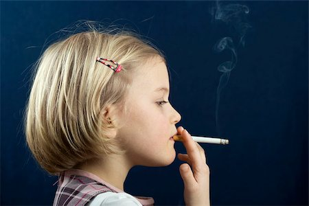 A young girl smoking a cigarette Stock Photo - Premium Royalty-Free, Code: 653-02834260