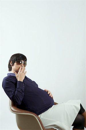A pregnant woman smoking Stock Photo - Premium Royalty-Free, Code: 653-02834263