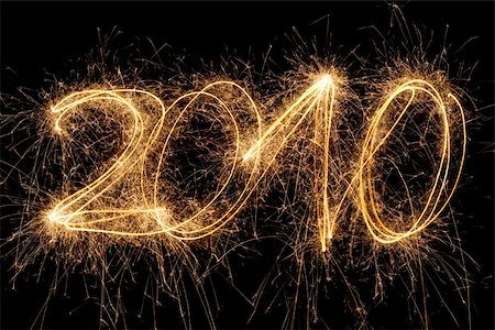 The number 2010 written with a sparkler Stock Photo - Premium Royalty-Free, Code: 653-02834412