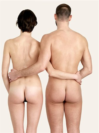 Rear view of a naked couple standing side by side Stock Photo - Premium Royalty-Free, Code: 653-02834800