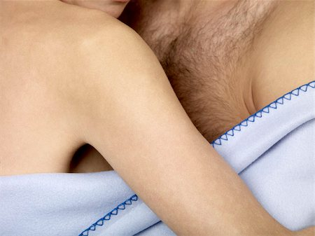 sleeping nude - Detail of a couple under a blanket Stock Photo - Premium Royalty-Free, Code: 653-02834840