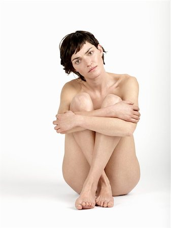 A naked woman sitting Stock Photo - Premium Royalty-Free, Code: 653-02834851