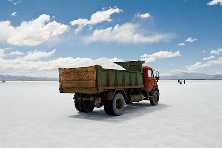 A dump truck on a salt flat, Salinas Grandes, Argentina Stock Photo - Premium Royalty-Free, Code: 653-02834931