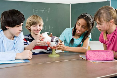 School students looking at a model of a human eye Stock Photo - Premium Royalty-Free, Code: 653-02835184